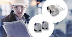 Four different hybrid capacitors; a man in the background.