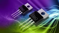 Two small, smart Low Dropout Regulators (LDOs) on a colorful background.